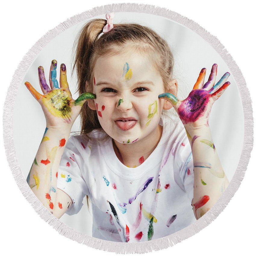 Girl Round Beach Towel featuring the photograph Little Girl Covered In Paint Making Funny Faces. by Michal Bednarek