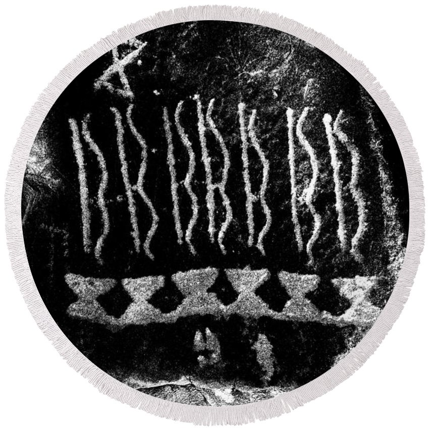 Petroglyphs Round Beach Towel featuring the photograph Native American Petroglyph On Sandstone Black And White by John Stephens