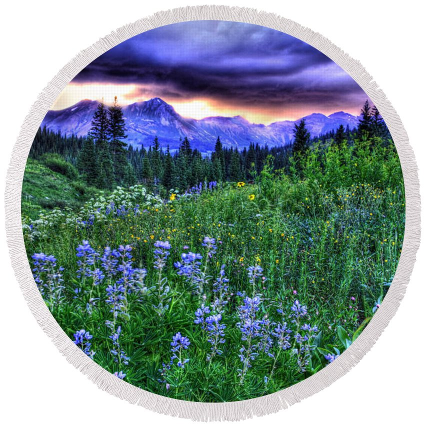 Colorado Round Beach Towel featuring the photograph Purple Skies And Wildflowers by Scott Mahon