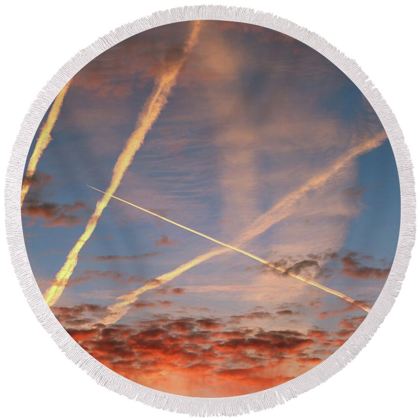 Sky Round Beach Towel featuring the photograph Red Morning Sky And Streams Of Condensed Vapor by Michal Boubin