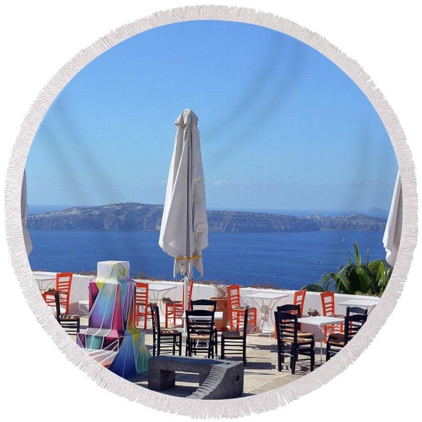 Santorini Round Beach Towel featuring the photograph Restaurant By The Aegean Sea In Santorini, Greece by Oana Unciuleanu