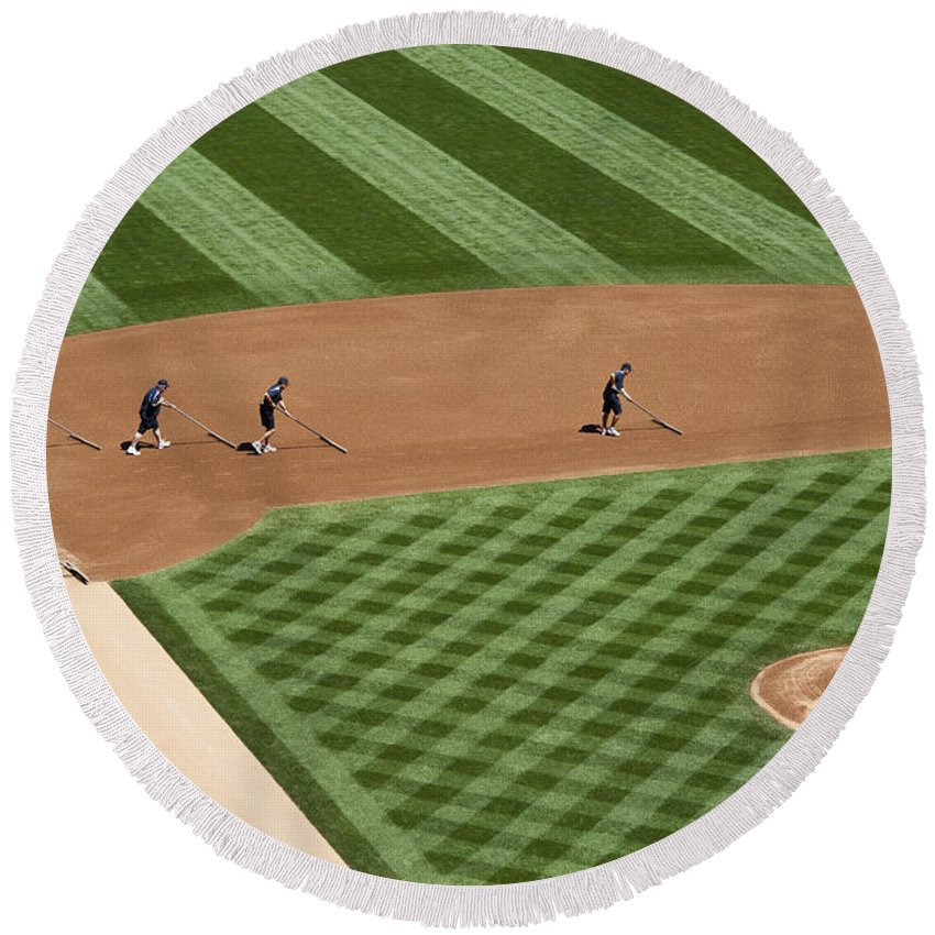 American Dream Round Beach Towel featuring the photograph Safeco Field Abstract Patterns With Ground Crew by Jim Corwin