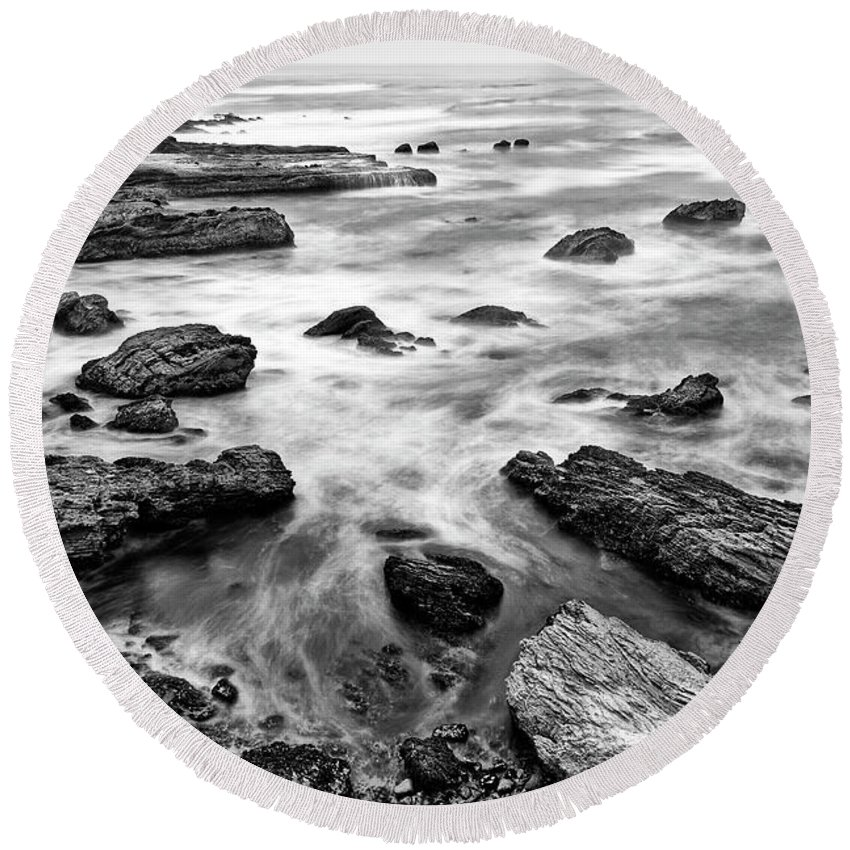 Montana De Oro Round Beach Towel featuring the photograph The Jagged Rocks And Cliffs Of Montana De Oro State Park by Jamie Pham