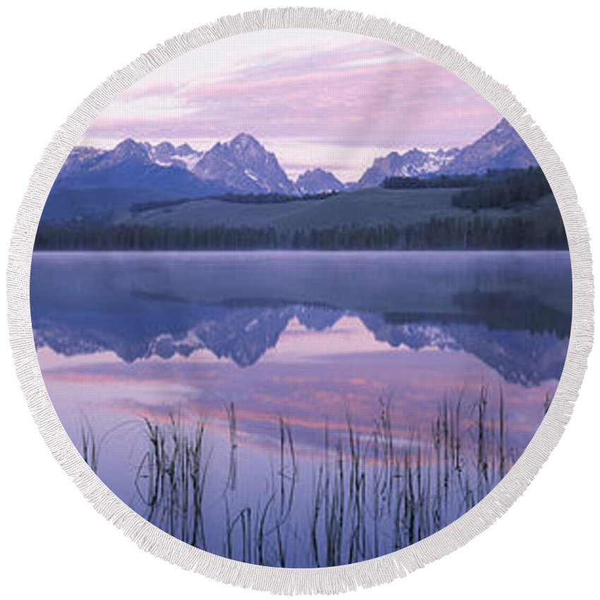 Photography Round Beach Towel featuring the photograph Reflection Of Mountains In A Lake by Panoramic Images