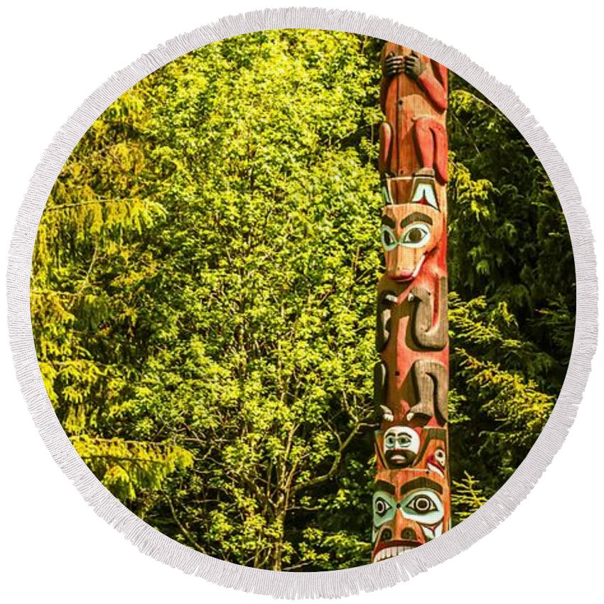 Village Round Beach Towel featuring the photograph Totems Art And Carvings At Saxman Village In Ketchikan Alaska by Alex Grichenko