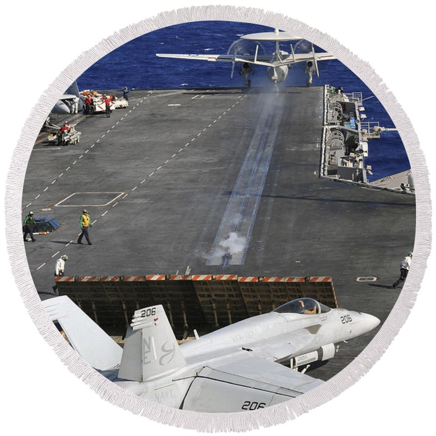 Uss Abraham Lincoln Round Beach Towel featuring the photograph An E-2c Hawkeye Launches by Stocktrek Images