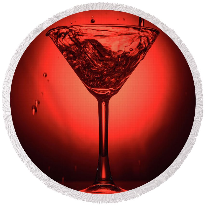 Alcohol Round Beach Towel featuring the photograph Cocktail Glass With Splashes On Red Background by Oleg Yermolov