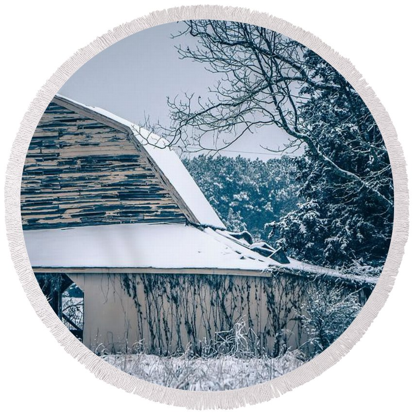Field Round Beach Towel featuring the photograph Fresh Snow Sits On The Ground Around An Old Barn by Alex Grichenko