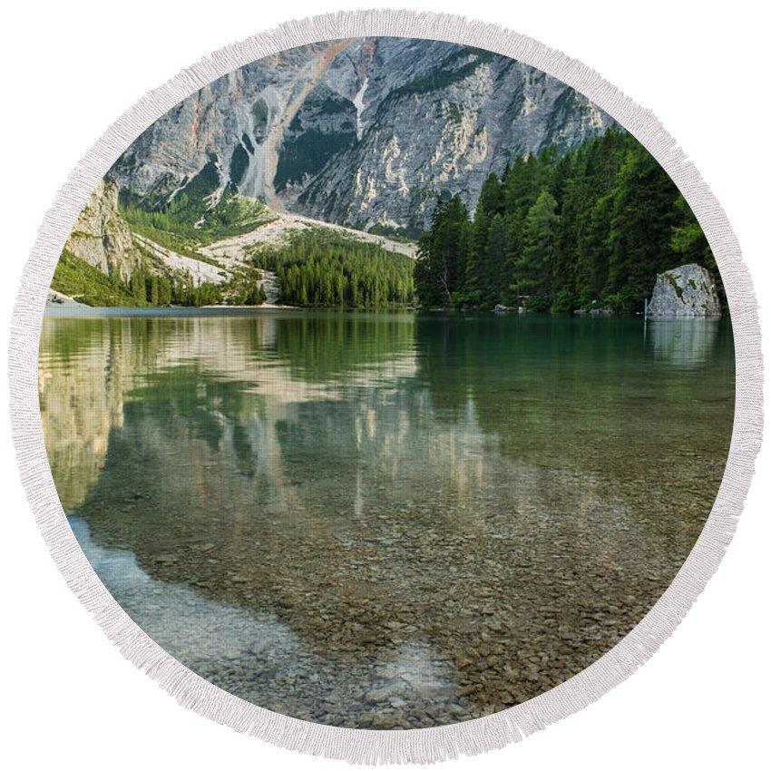 A Un Passo Dal Cielo Round Beach Towel featuring the photograph Lago Di Braies by Alfio Finocchiaro