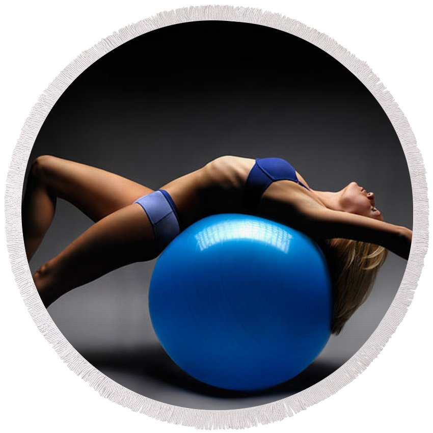 Woman Round Beach Towel featuring the photograph Woman On A Ball by Maxim Images Prints