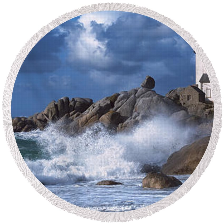 Photography Round Beach Towel featuring the photograph Lighthouse On The Coast, Pontusval by Panoramic Images