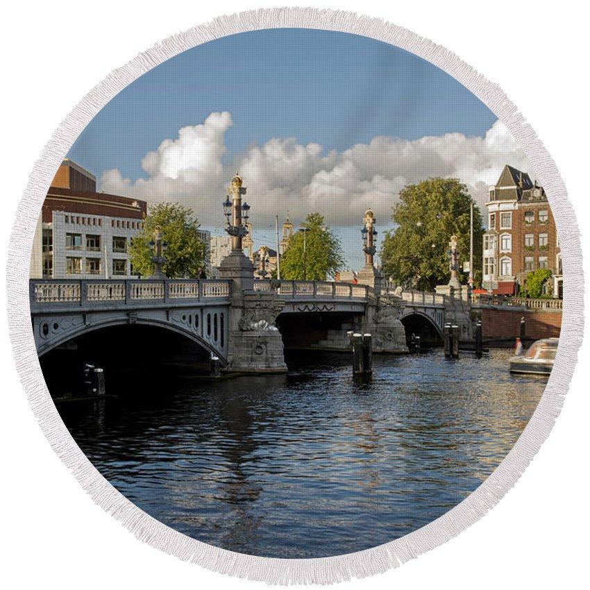 The Bridges Of Amsterdam Round Beach Towel featuring the photograph The Bridges Of Amsterdam by Yefim Bam
