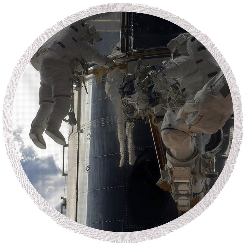 Sts-125 Round Beach Towel featuring the photograph Astronauts Participate by Stocktrek Images