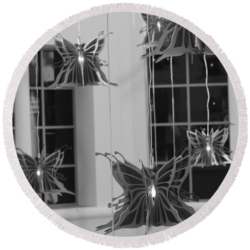 Black And White Round Beach Towel featuring the photograph Hanging Butterflies by Rob Hans