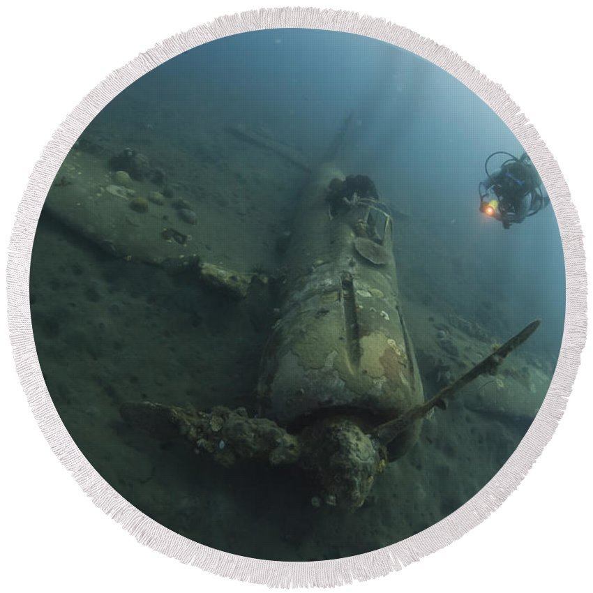 Kimbe Bay Round Beach Towel featuring the photograph Diver Explores The Wreck by Steve Jones
