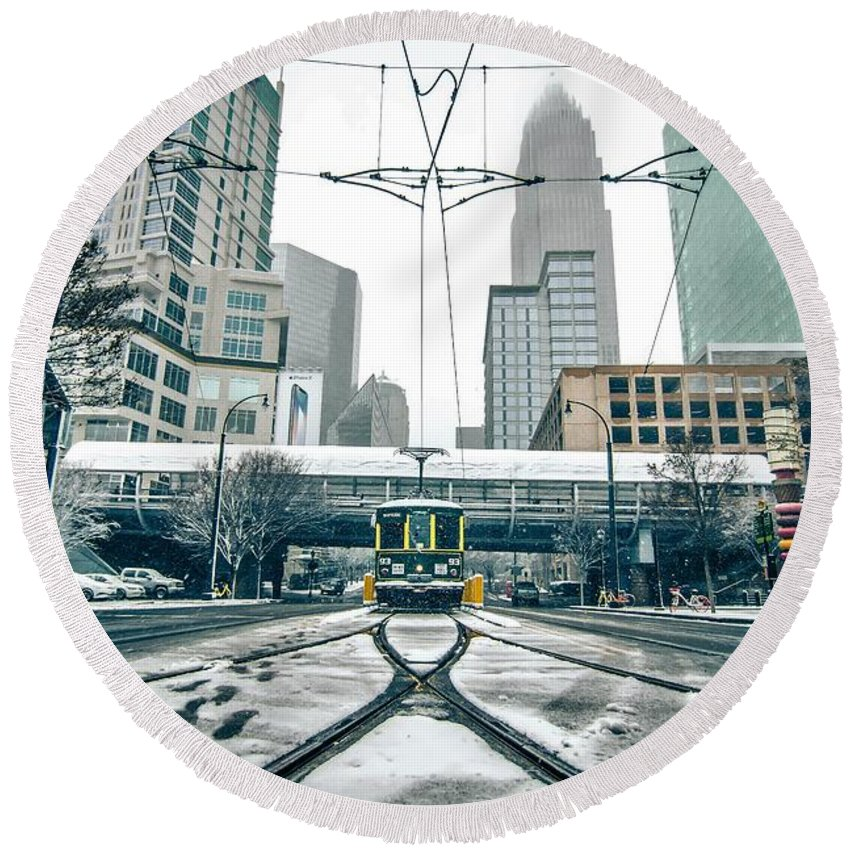 Streetcar Round Beach Towel featuring the photograph Streetcar Waiting For Passengers In Snowstrom In Uptown Charlott by Alex Grichenko