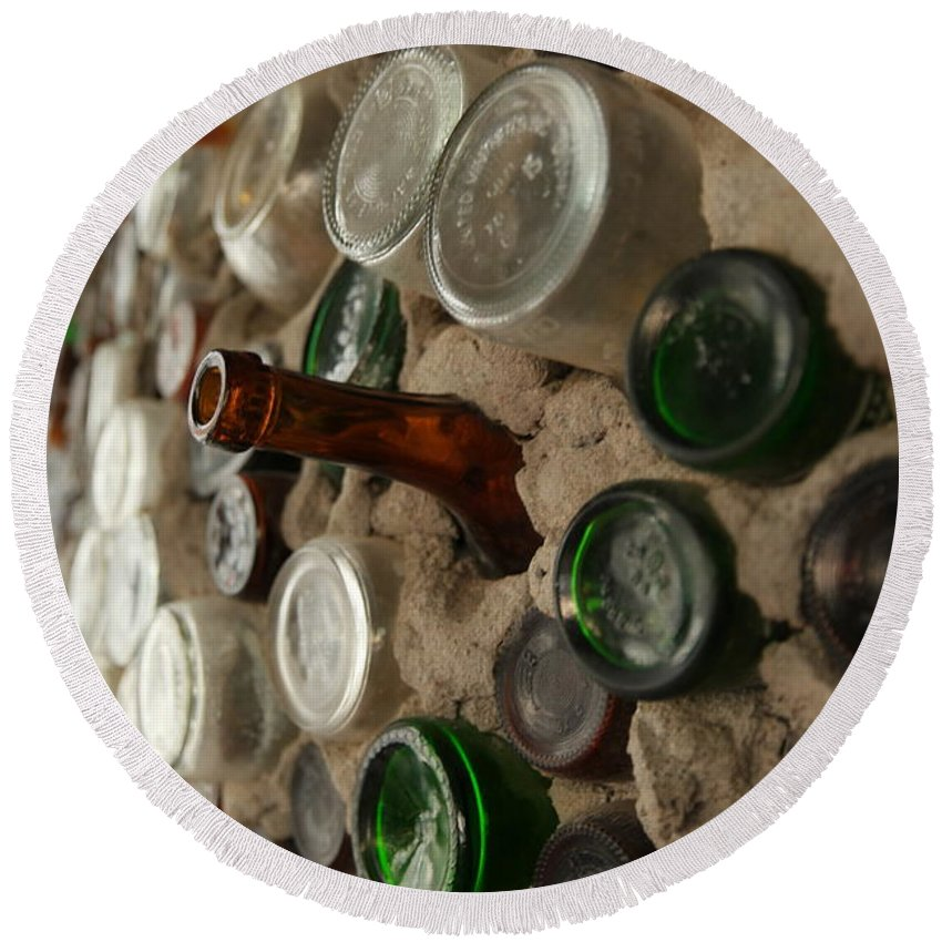 Bottle Round Beach Towel featuring the photograph A Bottle In The Wall by Jeff Swan