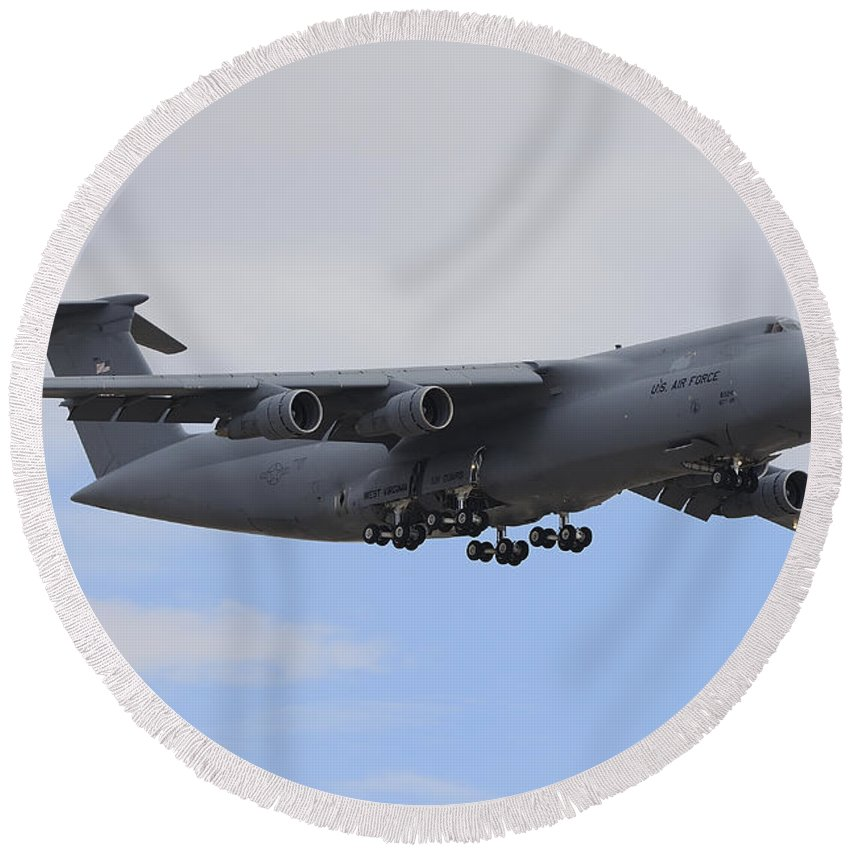 Horizontal Round Beach Towel featuring the photograph A C-5 Galaxy In Flight Over Nevada by Remo Guidi