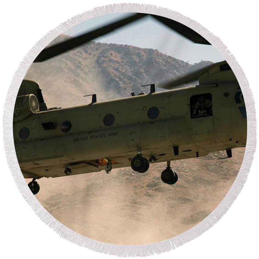 Operation Enduring Freedom Round Beach Towel featuring the photograph A Ch-47 Chinook Helicopter Kicks by Stocktrek Images