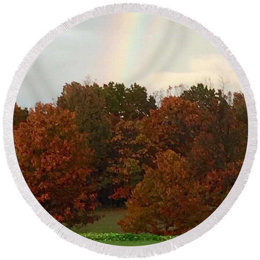 A Fall Rainbow Round Beach Towel featuring the photograph A Fall Rainbow by Wendy S Beatty