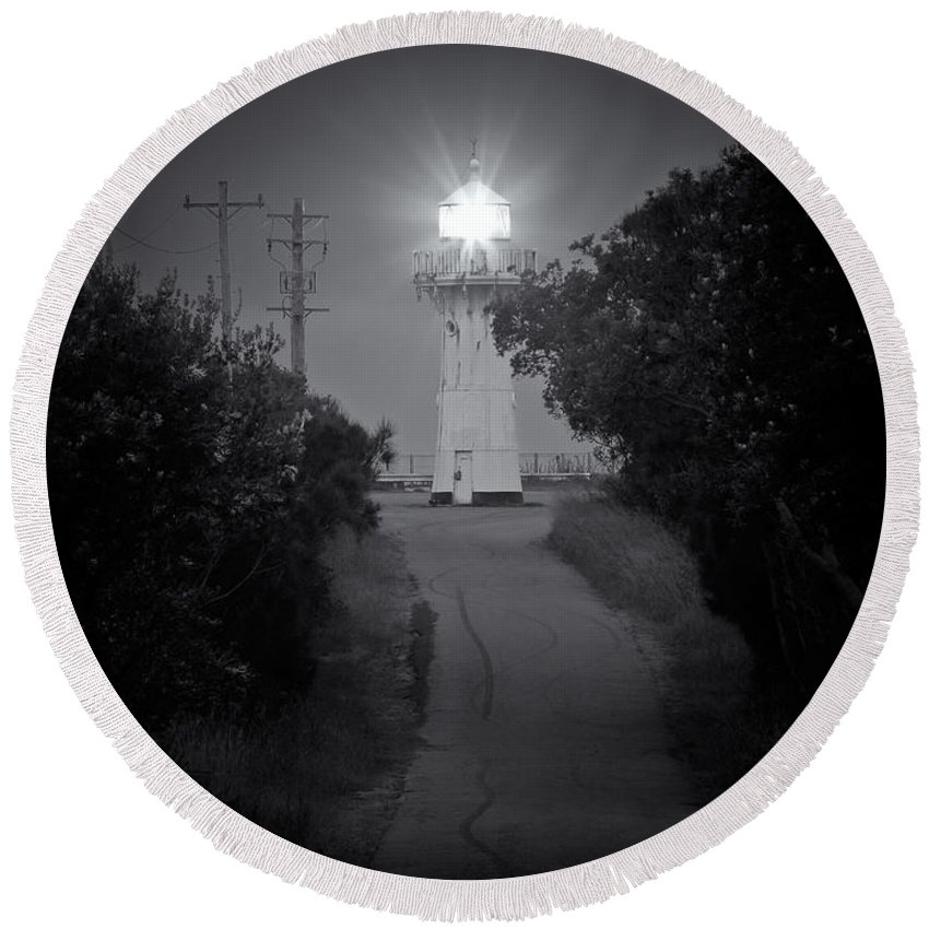 Light Round Beach Towel featuring the photograph A Light In A Dark Place by Nicholas Blackwell