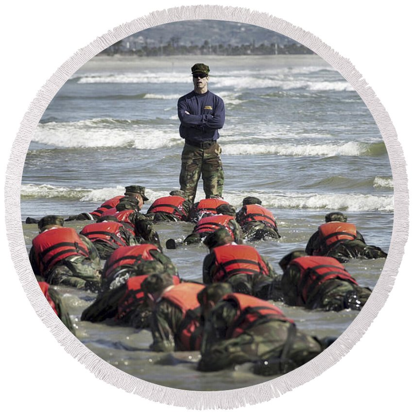 Buds Round Beach Towel featuring the photograph A Navy Seal Instructor Assists Students by Stocktrek Images