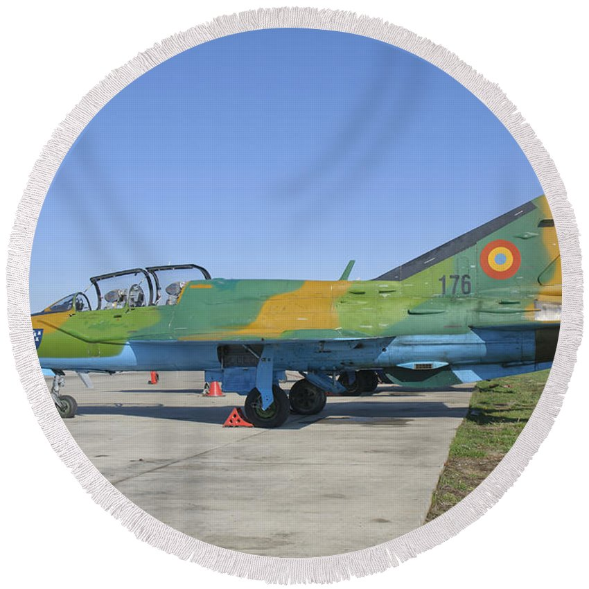 Horizontal Round Beach Towel featuring the photograph A Romanian Air Force Mig-21b Airplane by Giovanni Colla