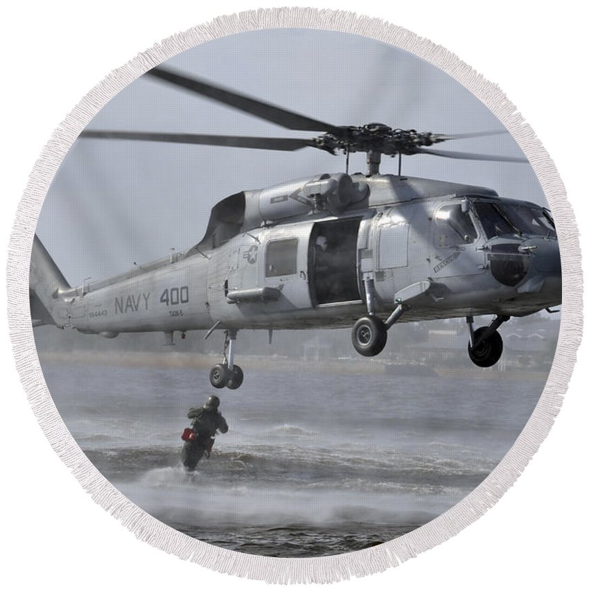 Helo Round Beach Towel featuring the photograph A Search And Rescue Swimmer Jumps by Stocktrek Images