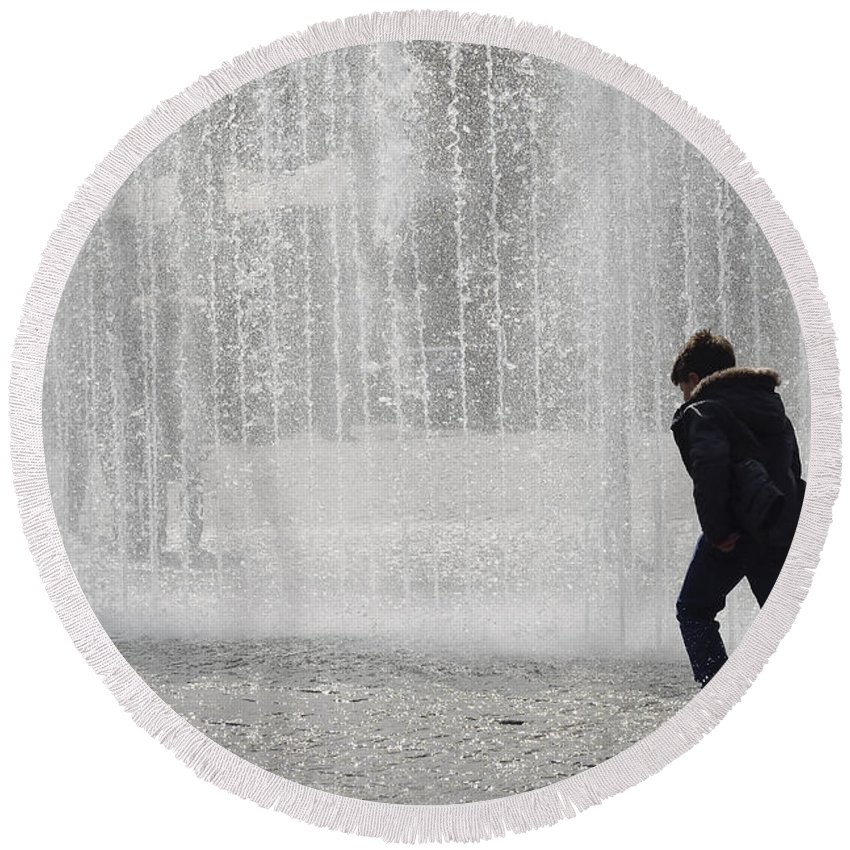 Water Round Beach Towel featuring the photograph A Silhouette Of The Boy Against A Fountain by TouTouke A Y