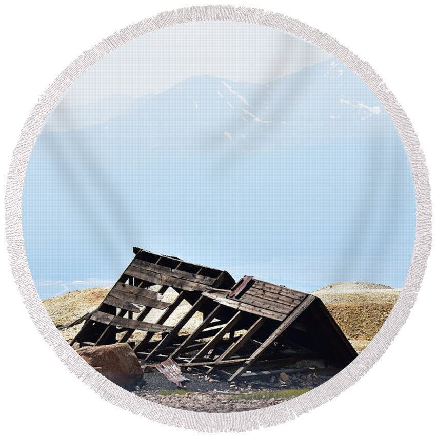 Abandoned Round Beach Towel featuring the photograph Abandoned In A Sea Of Mining Tailings by Sharon Horning