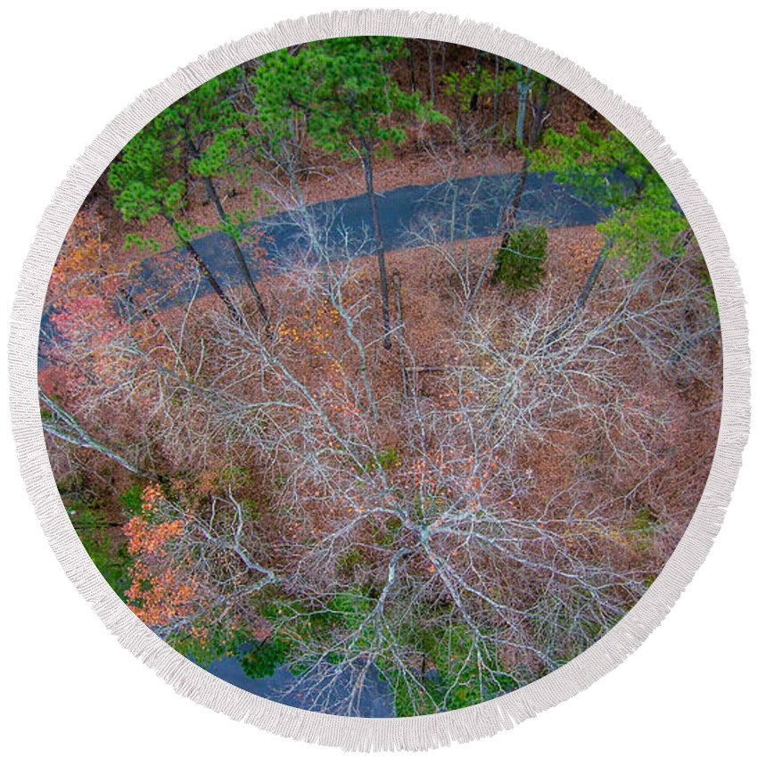 Forest Round Beach Towel featuring the photograph Aerial View Over Wooded Forest And Road by Alex Grichenko