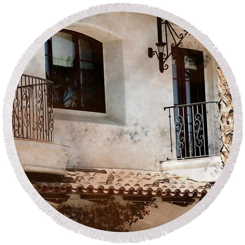 Aged Photograph Round Beach Towel featuring the photograph Aged Stucco Building Balcony with Terracotta Roof by Colleen Cornelius