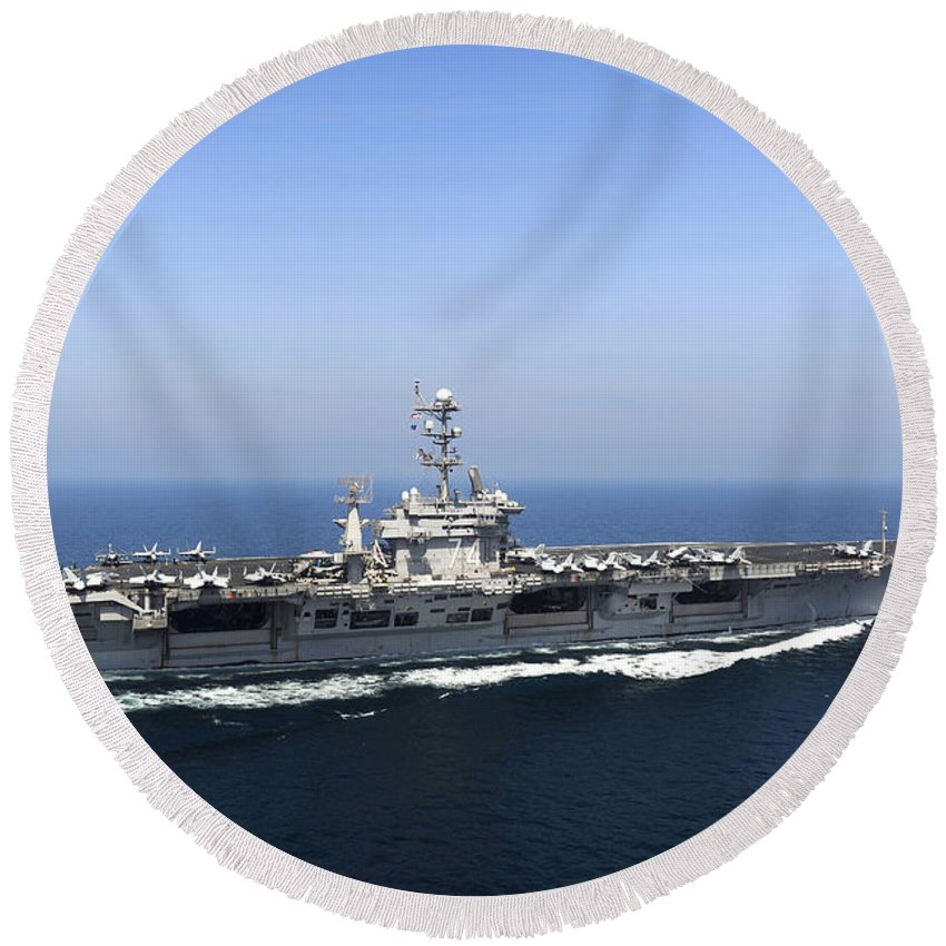 Operation New Dawn Round Beach Towel featuring the photograph Aircraft Carrier Uss John C. Stennis by Stocktrek Images