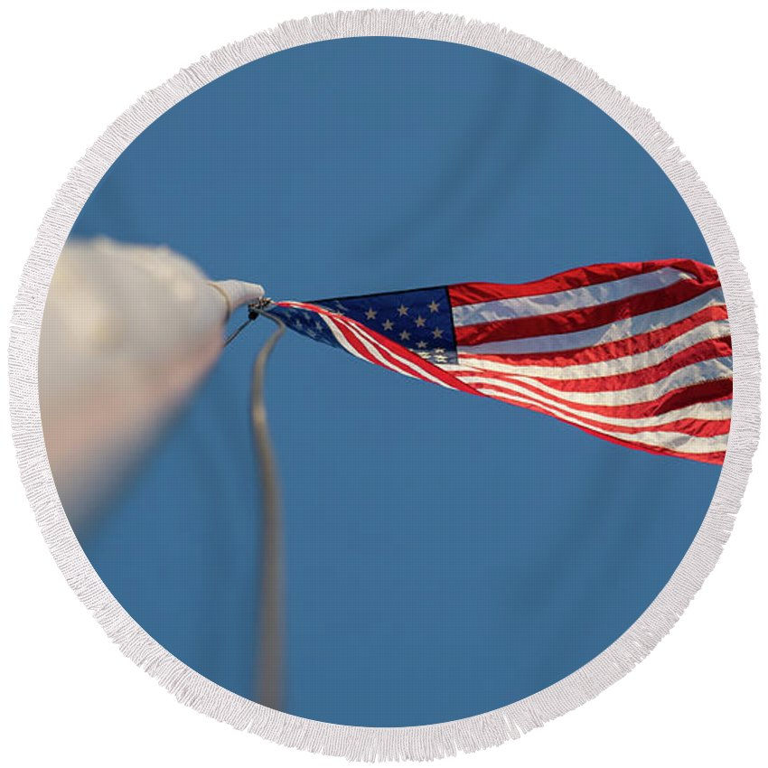 Usa Round Beach Towel featuring the photograph American Flag At The End Of Tall Post With Blue Skies by PorqueNo Studios
