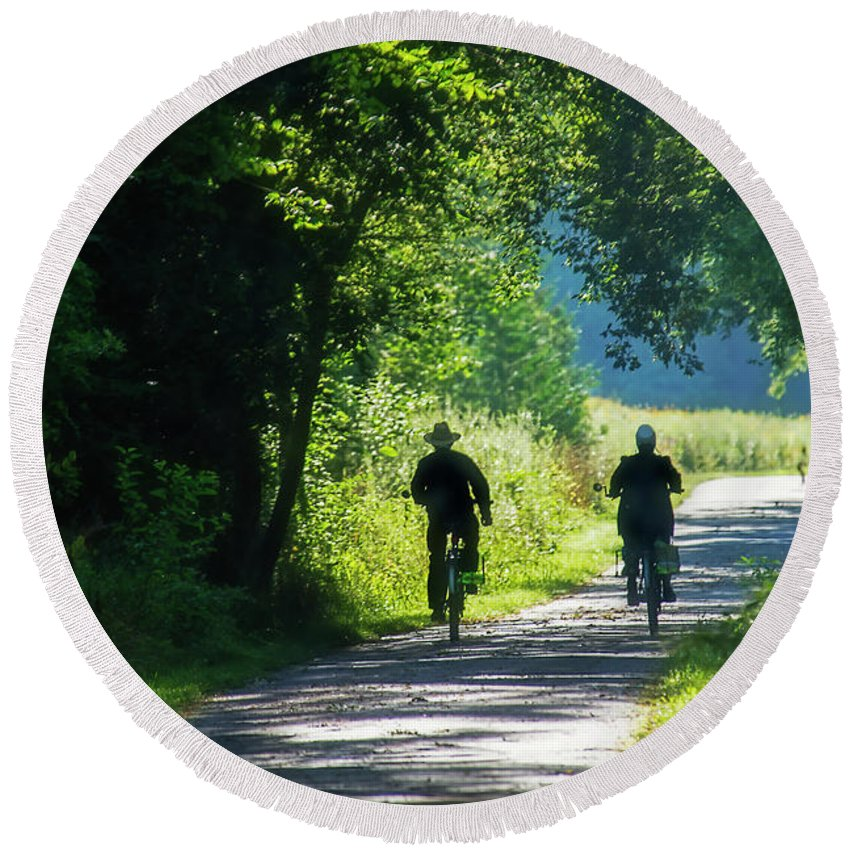 Pumpkin-vine Trail Round Beach Towel featuring the photograph Amish Couple On Bicycles by David Arment