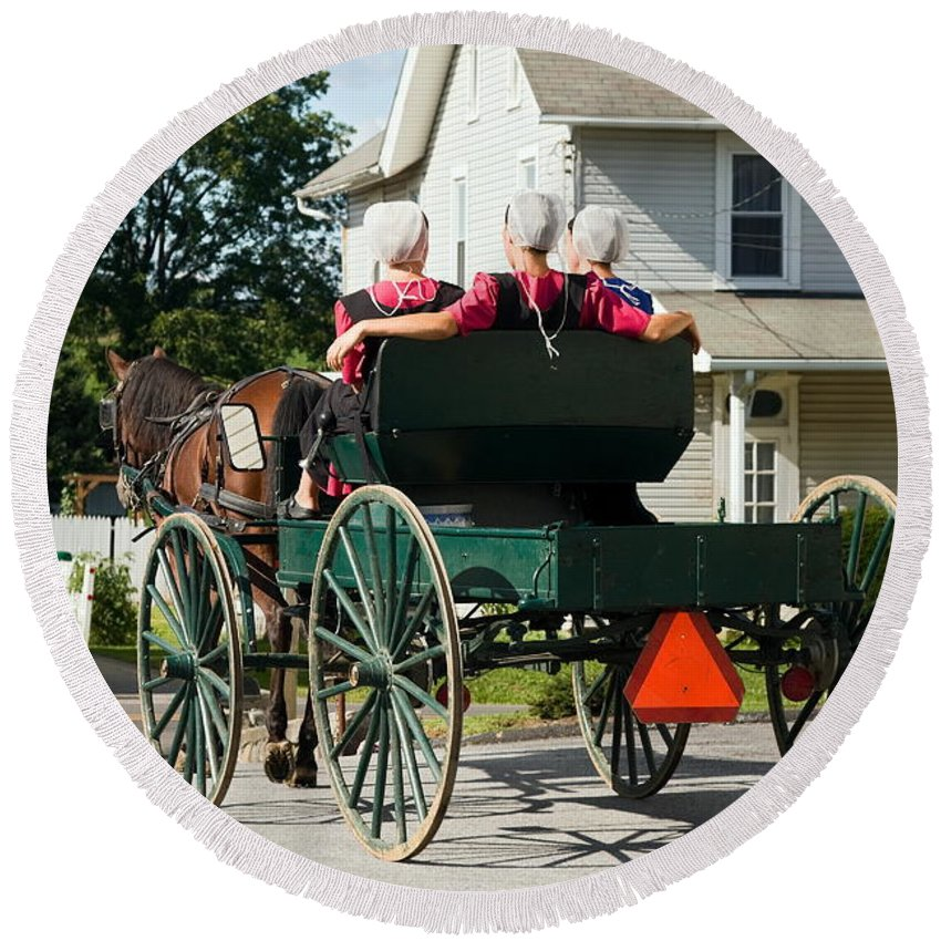 Amish Women Riding In Open Horse Drawn Cart Round Beach Towel featuring the photograph Amish Women by Sally Weigand