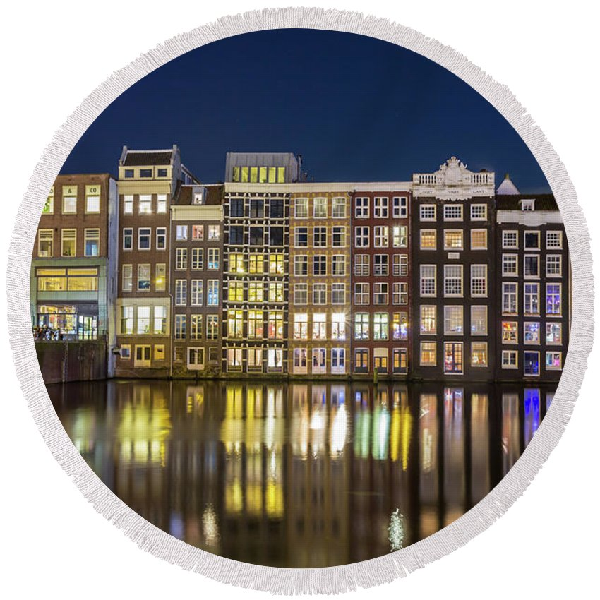 City Round Beach Towel featuring the photograph Amsterdam Canal Houses At Night by Andrew Balcombe