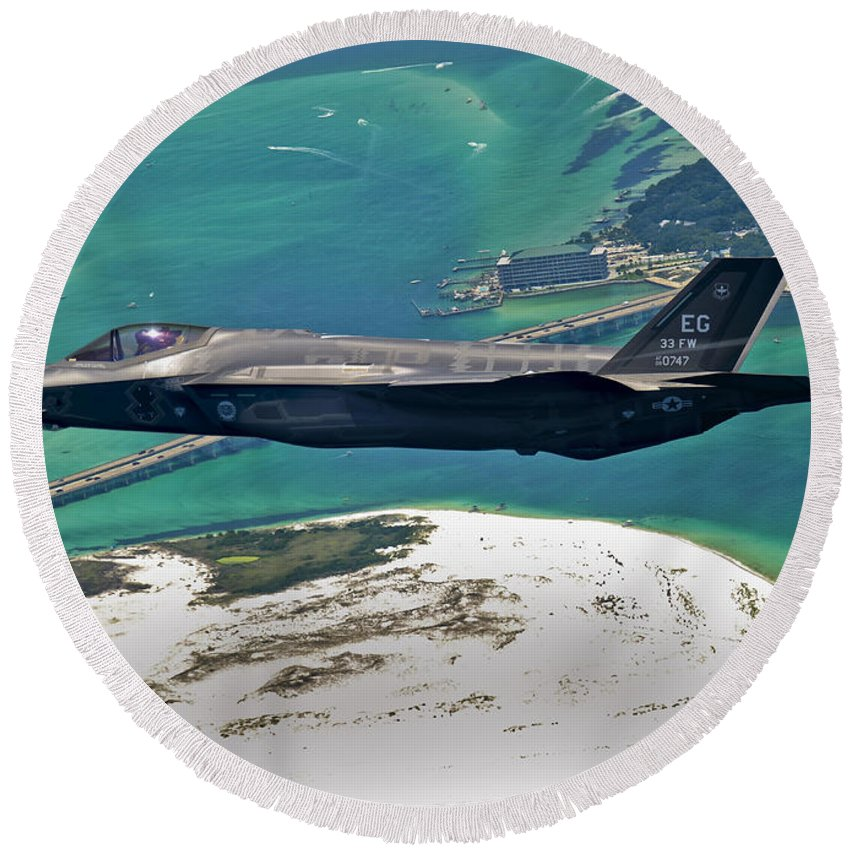Stealth Round Beach Towel featuring the photograph An F-35 Lightning II Flies Over Destin by Stocktrek Images