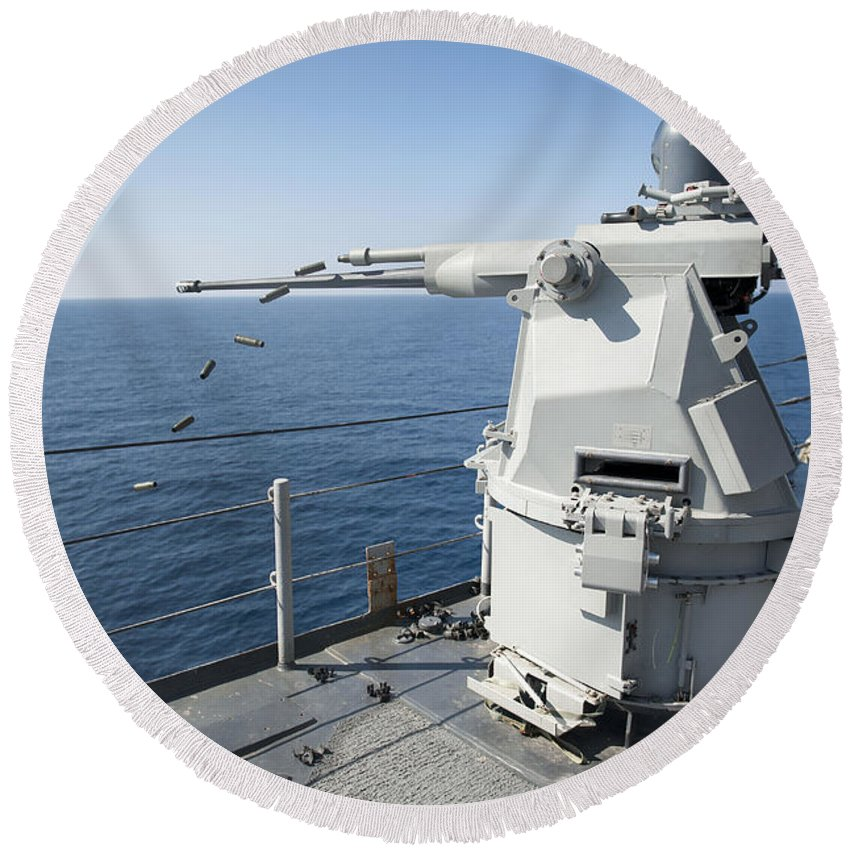 No People Round Beach Towel featuring the photograph An Mk-38 Machine Gun System Aboard Uss by Stocktrek Images