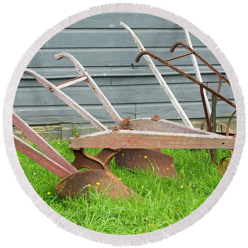 Cobleskill Ny Round Beach Towel featuring the photograph Antique Plows by Joan D Squared Photography