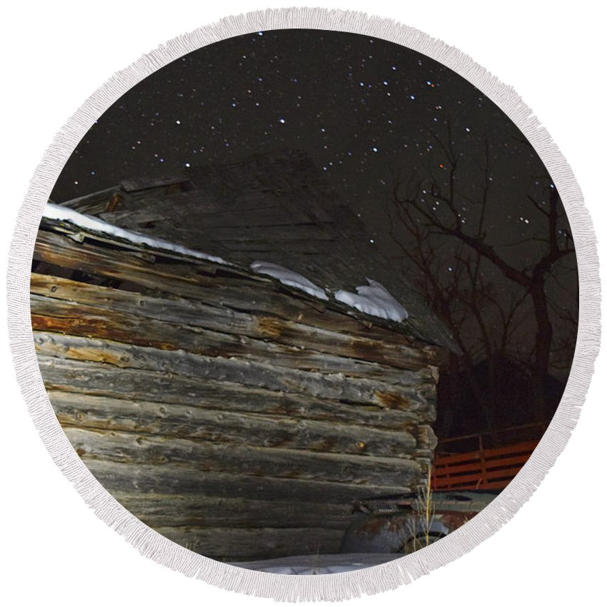 Antique Stars Nights Log Home Color Snow Old Trucks Farm Ranch Colorado Round Beach Towel featuring the photograph Antique Stars by Branden Kruis