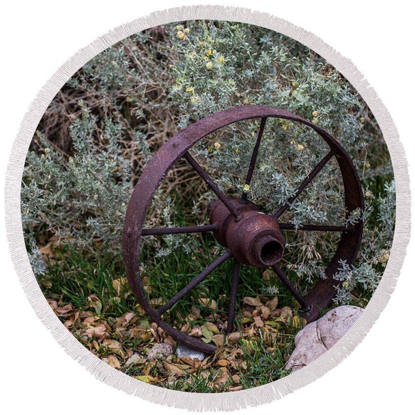 Antique Wagon Wheel Round Beach Towel featuring the photograph Antique Steel Wagon Wheel by Paul Freidlund