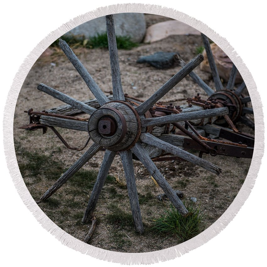 Antique Wagon Wheel Round Beach Towel featuring the photograph Antique Wagon Wheel by Paul Freidlund
