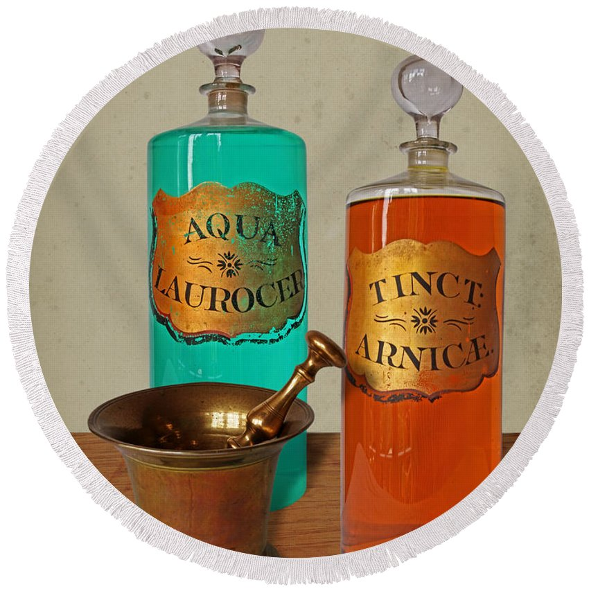 Apothecary Bottles Round Beach Towel featuring the photograph Apothecary Bottles And Brass Pestle And Mortar by Gill Billington