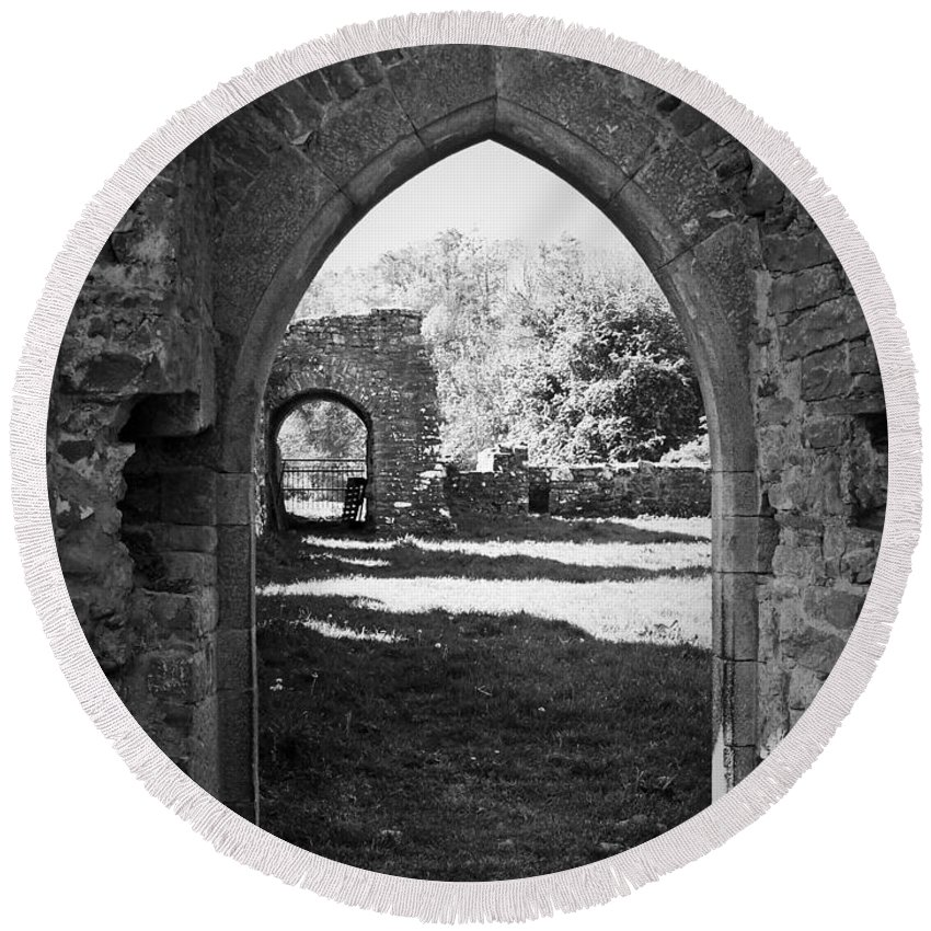 Irish Round Beach Towel featuring the photograph Arched Door At Ballybeg Priory In Buttevant Ireland by Teresa Mucha