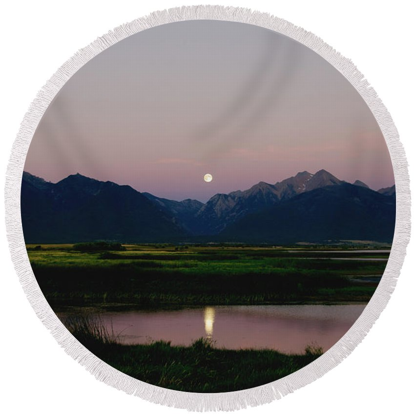 Full Moon Round Beach Towel featuring the photograph August Moon Over Mission Mountains And Ninepipes Refuge by Larry Kjorvestad