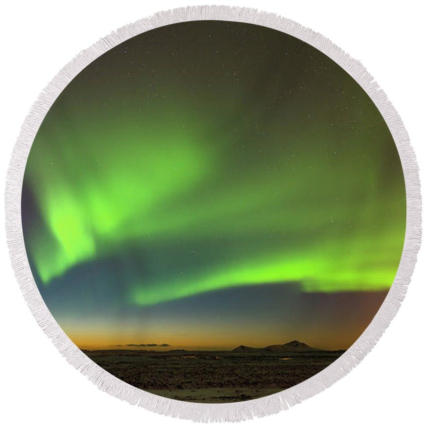 Iceland Round Beach Towel featuring the photograph Aurora Above Keflavik In Iceland. by Andy Astbury
