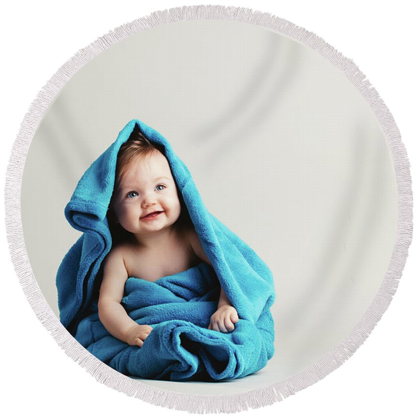Baby Round Beach Towel featuring the photograph Baby Girl Covered With A Blue Warm Blanket by Michal Bednarek
