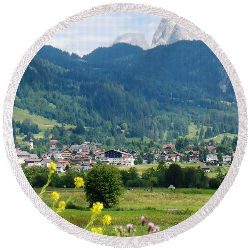 Bavaria Round Beach Towel featuring the photograph Bavarian Alps With Village And Flowers by Carol Groenen
