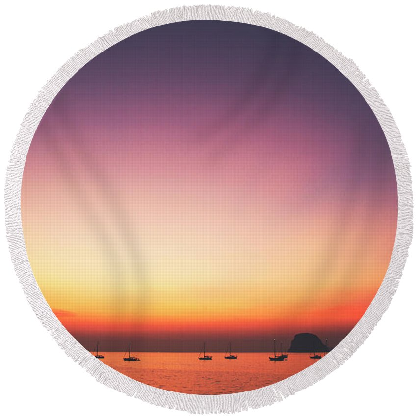 Awe Round Beach Towel featuring the photograph Beautiful And Serene Sunset View Over A Lagoon Bay With Couple Of Yachts And Islands In Distance by Srdjan Kirtic